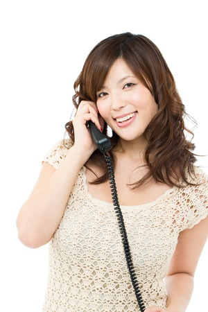 Beautiful young woman using a phone Stock Photo - 15843635