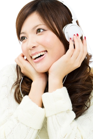 Beautiful young woman listening to music photo