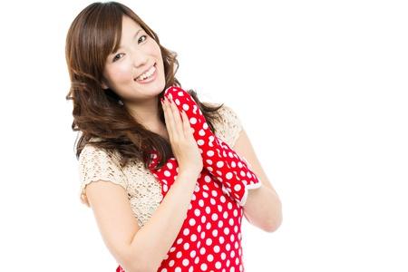 Beautiful young woman wearing an apron