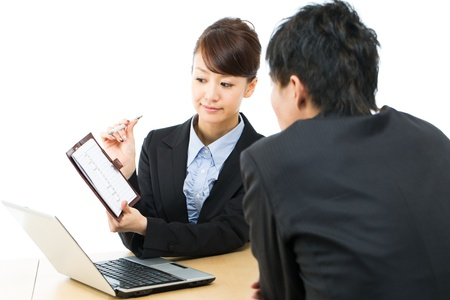 negotiation: Young asian smiling businesswoman and businessman