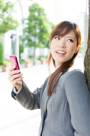 Beautiful businesswoman using a cellular phone photo
