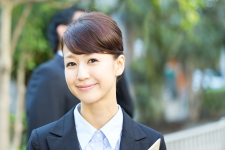 Young asian smiling businesswoman and businessman Stock Photo - 16119964