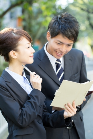 women and men: Young asian smiling businesswoman and businessman