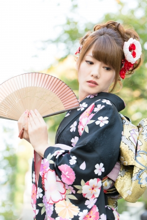 Beautiful japanese kimono woman in the town photo