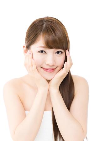 白い背景の上の美しい若い女性 写真素材