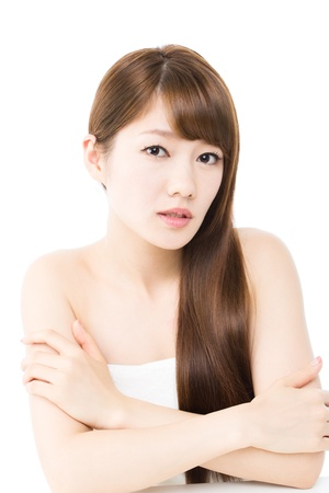Beautiful young woman on white background