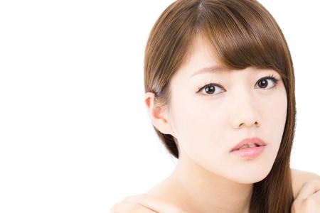 Schöne junge Frau auf weißem Hintergrund Standard-Bild - 16336542