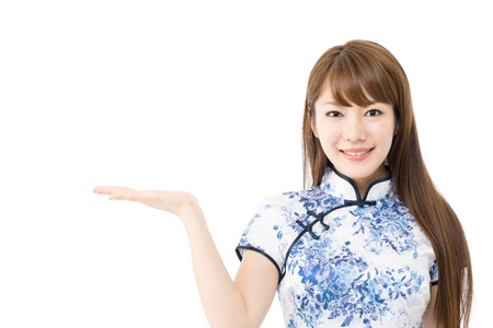 Beautiful asian woman in traditional chinese clothing on white background Stock Photo