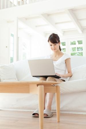Beautiful young woman relaxing in the room Standard-Bild