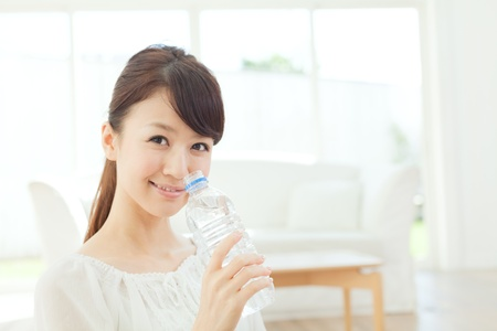 Beautiful young woman relaxing in the room 写真素材