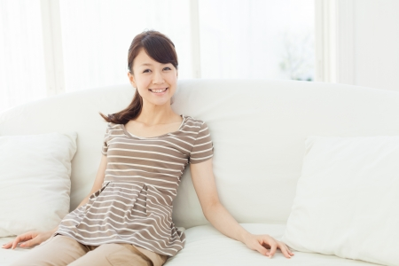 Beautiful young woman relaxing in the room Stock Photo - 16565525