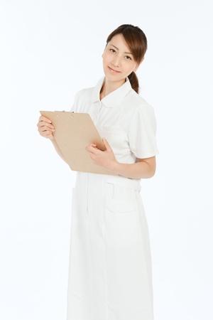 Beautiful asian nurse on white background 写真素材