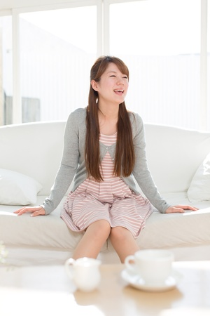 Beautiful young woman relaxing room photo