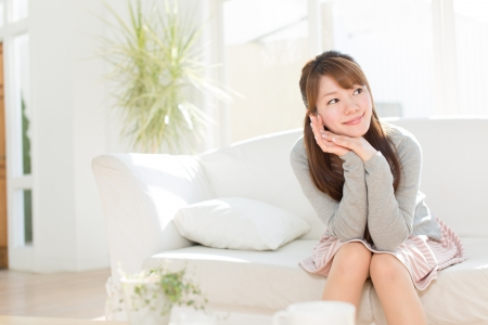 woman relaxing: Beautiful young woman relaxing room