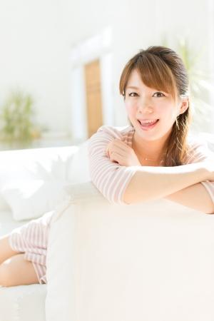 Beautiful young woman relaxing room