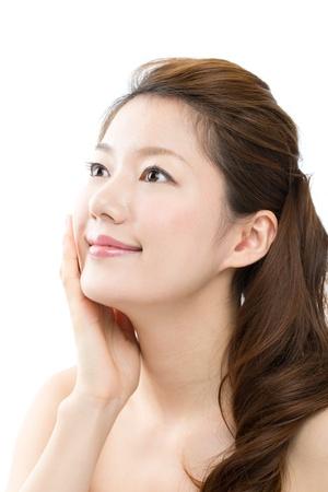Schöne junge asiatische Frau auf weißem Hintergrund Standard-Bild - 16825617