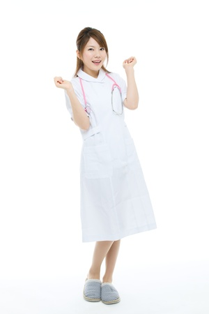 Beautiful asian nurse on white background Stock Photo - 16879091