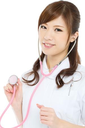 Beautiful asian nurse on white background photo