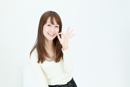 Beautiful asian woman showing okay sign