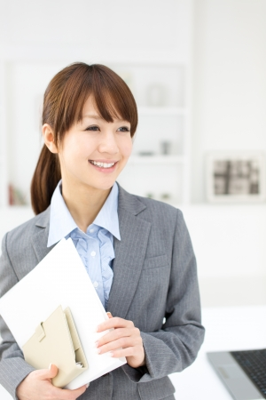 Beautiful asian businesswoman working in office photo