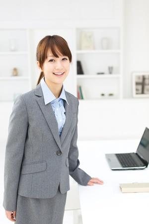 Beautiful asian businesswoman working in office photo