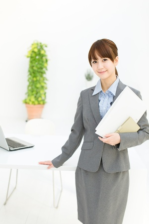 Beautiful young businesswoman working in office  photo