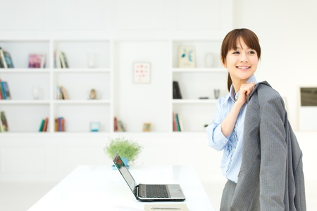 gray suit: Beautiful young businesswoman working in office