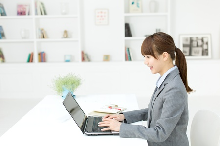 Beautiful young businesswoman working in office