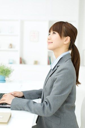 Beautiful young businesswoman working in office Stock Photo - 17273253
