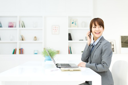 Beautiful young businesswoman working in office Stock Photo - 17273167