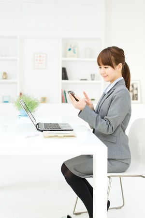 Beautiful young businesswoman working in office  Stock Photo - 17273250
