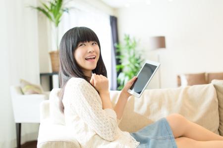 Beautiful asian woman relaxing in the room