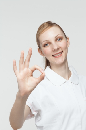 Beautiful caucasian nurse on white background photo
