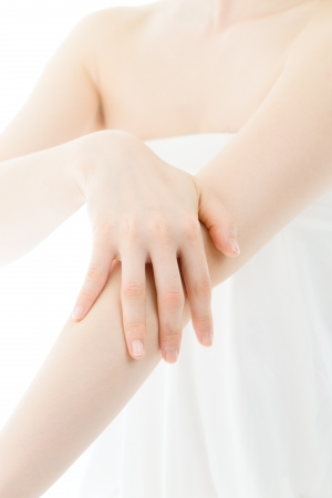 sensitive skin: Beautiful young woman hands on white background