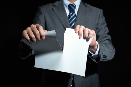 breaking: Businessman tear paper concept for breaking contract