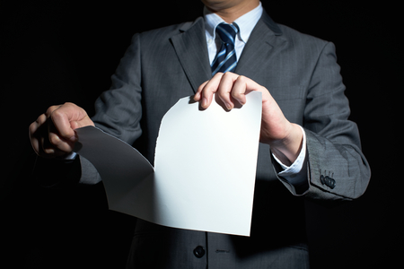breaking the rules: Businessman tear paper concept for breaking contract