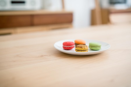 table wood: Delicious breakfast some macarons in a dish