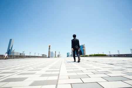 business man walking on the road 写真素材