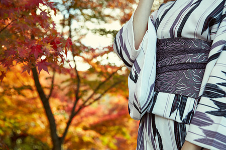 Japanese kimono woman and red leaves in autumn Stock Photo