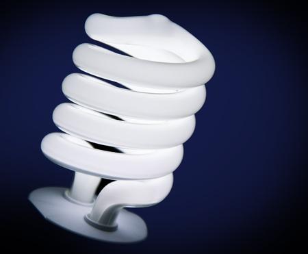 ecologically: Energy-saving lamp on dark blue background