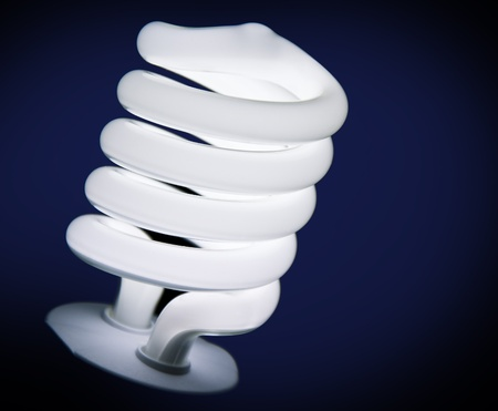 savers: Energy-saving lamp on dark blue background