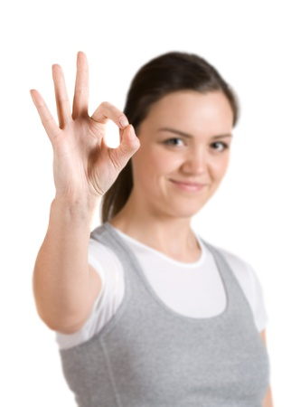 Caucasian girl shows gesture okay (out-of-focus) Stock Photo