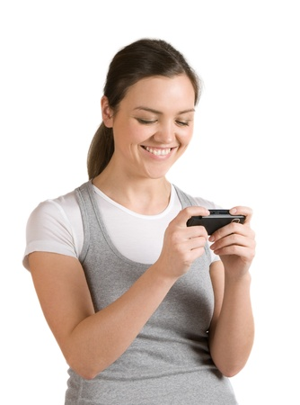 A pretty girl reads a joyful message on your mobile phone photo