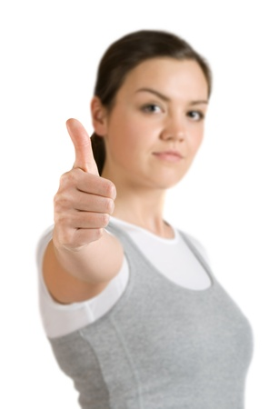 Caucasian girl shows gesture okay (out-of-focus) photo