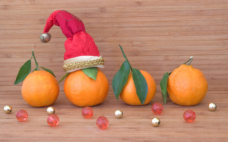 Tangerines in Santa hats.