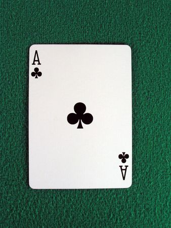em: ace of clubs on a green felt table top.