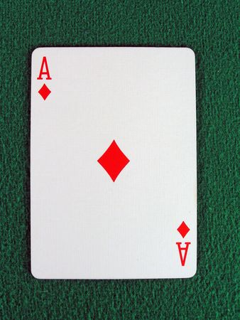 em: ace of diamonds on a green felt table top. Stock Photo