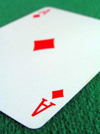 ace of diamonds on a green felt table top Stock Photo