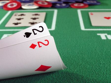 A pair of 2s as a starting hand in a game of texas holdem. Stock Photo