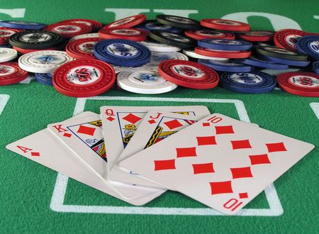 Royal flush of diamonds in a poker hand on a green felt table top. Stock Photo